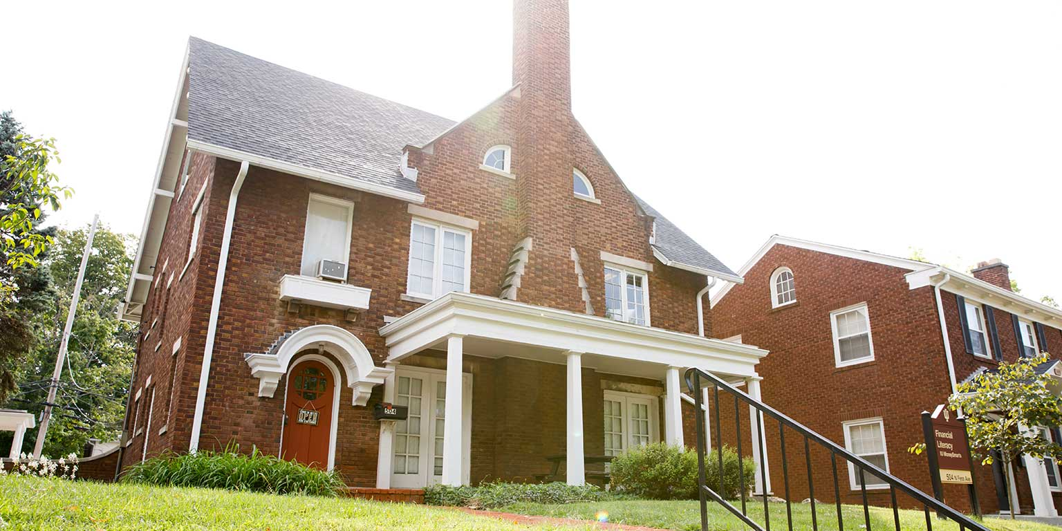 A brick house with white trim