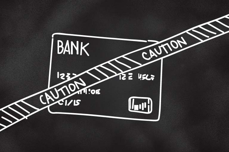 A drawing of a credit card with a strip of Caution tape over the front of it.
